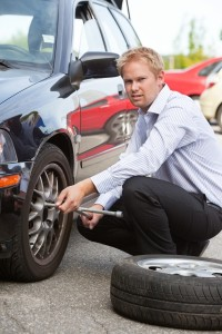 1930258-business-man-replacing-tire